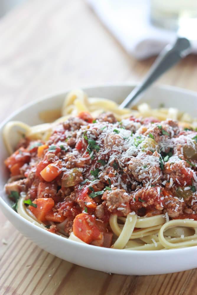 Crockpot Bolognese Sauce - all in crockpot for easy weeknight dinner. Serve over pasta, mashed potatoes, lasagne, baked potato or in casseroles! | littlebroken.com @littlebroken #crockpot