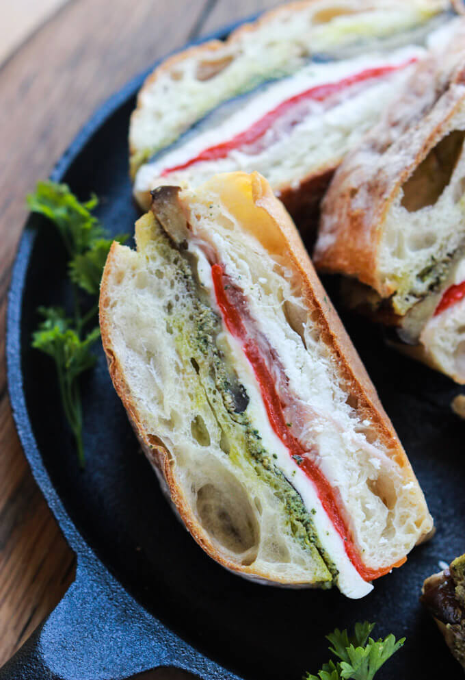 Eggplant, Prosciutto and Pesto Pressed Sandwich - homemade pesto and melt in your mouth prosciutto are just a few layers of this Italian inspired sandwich that's perfect as a lunch or appetizer | littlebroken.com @littlebroken #sandwich #recipe