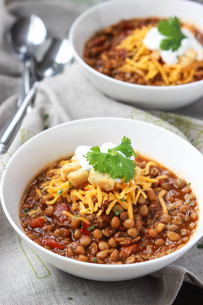 lentil chili in white bowl