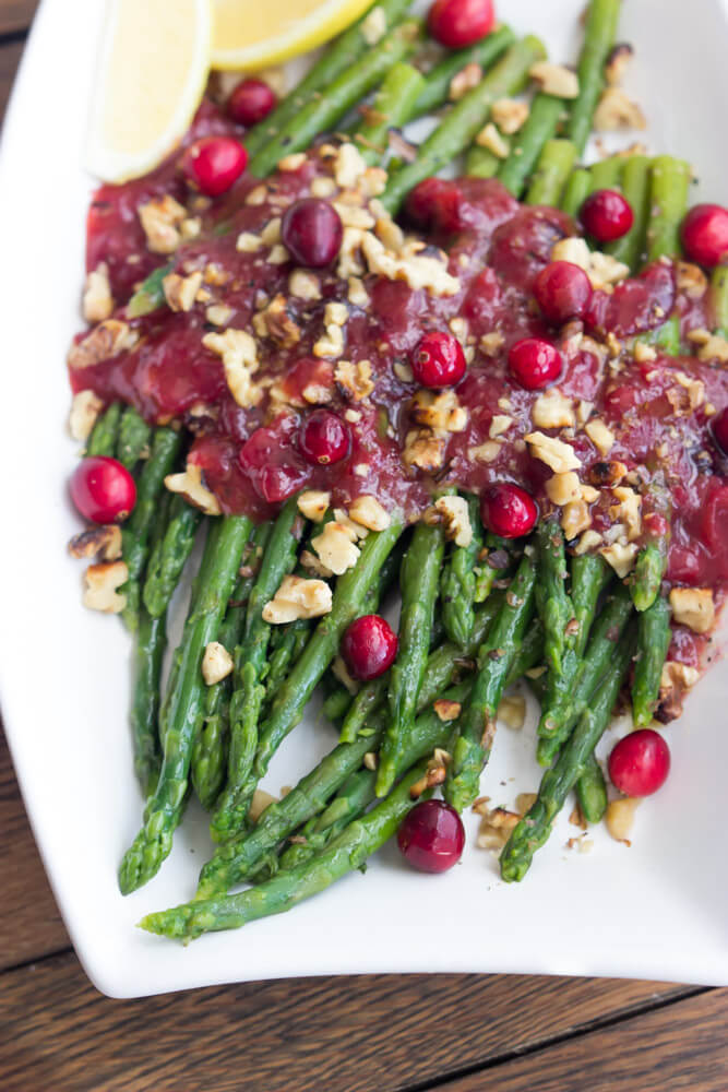 Asparagus with Cranberry Honey Vinaigrette - festive thanksgiving side dish that combines cranberry sauce with honey vinaigrette and asparagus. Delicious alternative to green beans | littlebroken.com @littlebroken