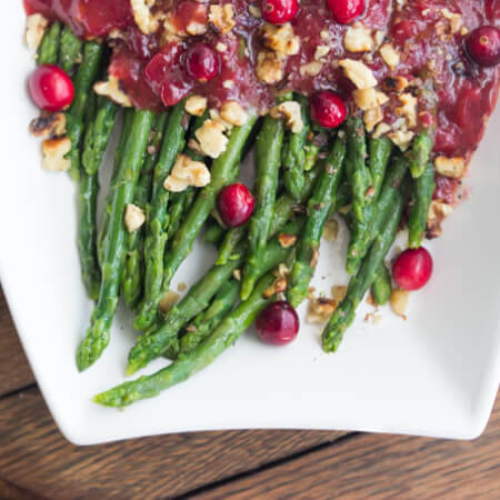 Festive holiday side dish that combines cranberry sauce with honey vinaigrette and asparagus. Super healthy, easy, and quick. | littlebroken.com @littlebroken #thanksgiving #sidedish #asparagus