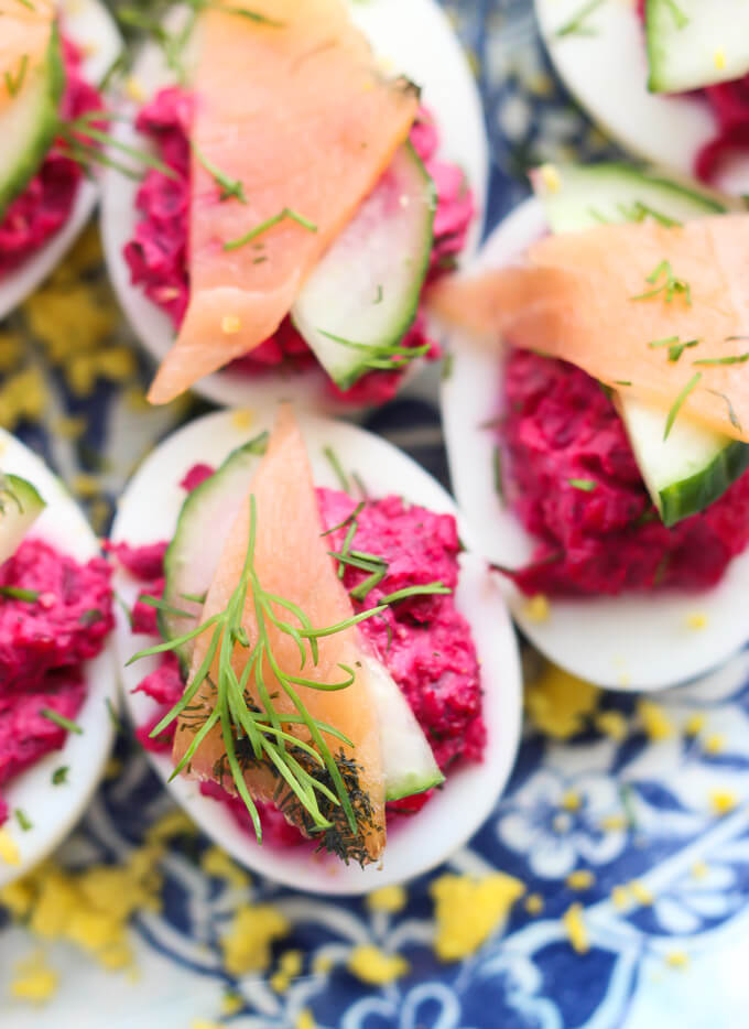 overhead close up deviled eggs with beet filling