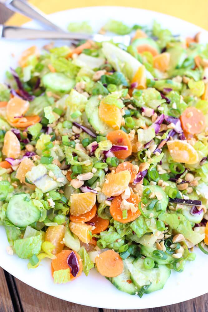 Healthy salad greens combined with crispy veggies and mandarins in a slightly sweet dressing | littlebroken.com @littlebroken