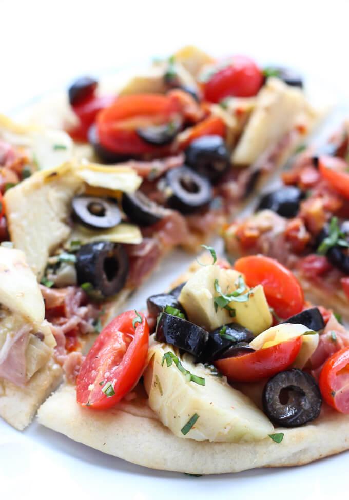 Quick and easy mediterranean salad atop of store-bought flatbread. Tasty light lunch, appetizer or snack   littlebroken.com @littlebroken