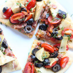 Quick and easy mediterranean salad atop of store-bought flatbread. Perfect for meatless monday as an appetizer, light lunch, or snack | littlebroken.com @littlebroken
