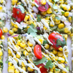 Thin crust flatbread with guacamole, corn, tomatoes, and drizzle of avocado cream makes an easy light lunch or meatless dinner | LittleBroken.com @littlebroken