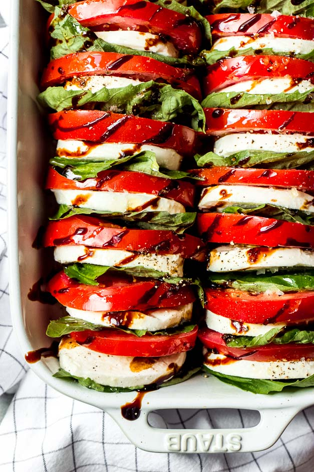 Tomato mozzarella salad with balsamic reduction light and easy appetizer or side dish loaded with tomatoes fresh mozzarella and forumfinder Images