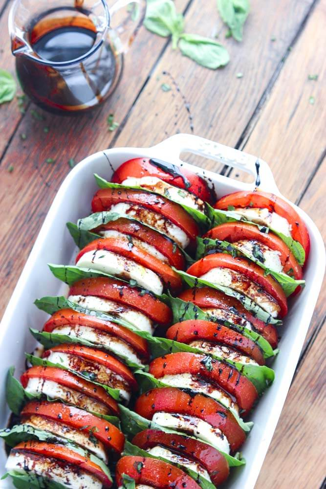 Tomato mozzarella salad with balsamic reduction little broken light and easy appetizer or side dish loaded with tomatoes fresh mozzarella and forumfinder Gallery