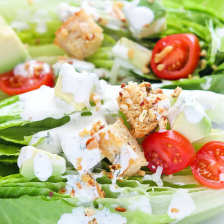 Crisp romaine wedges topped with avocado, tomatoes, almond-parmesan croutons with a drizzle of Buttermilk Ranch Dressing for delicious light lunch or elegant dinner salad | littlebroken.com @littlebroken
