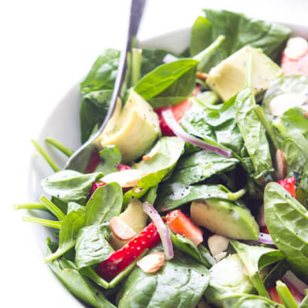 Quick and easy spinach salad with creamy and strawberries, tossed in homemade poppyseed dressing | littlebroken.com @littlebroken