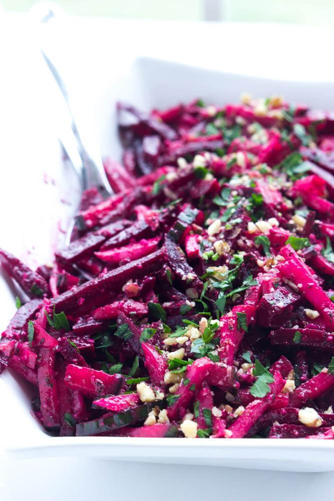 Simple and easy vegetable salad with beets, cucumbers, and radishes, tossed in a crunchy basil pesto vinaigrette   littlebroken.com @littlebroken