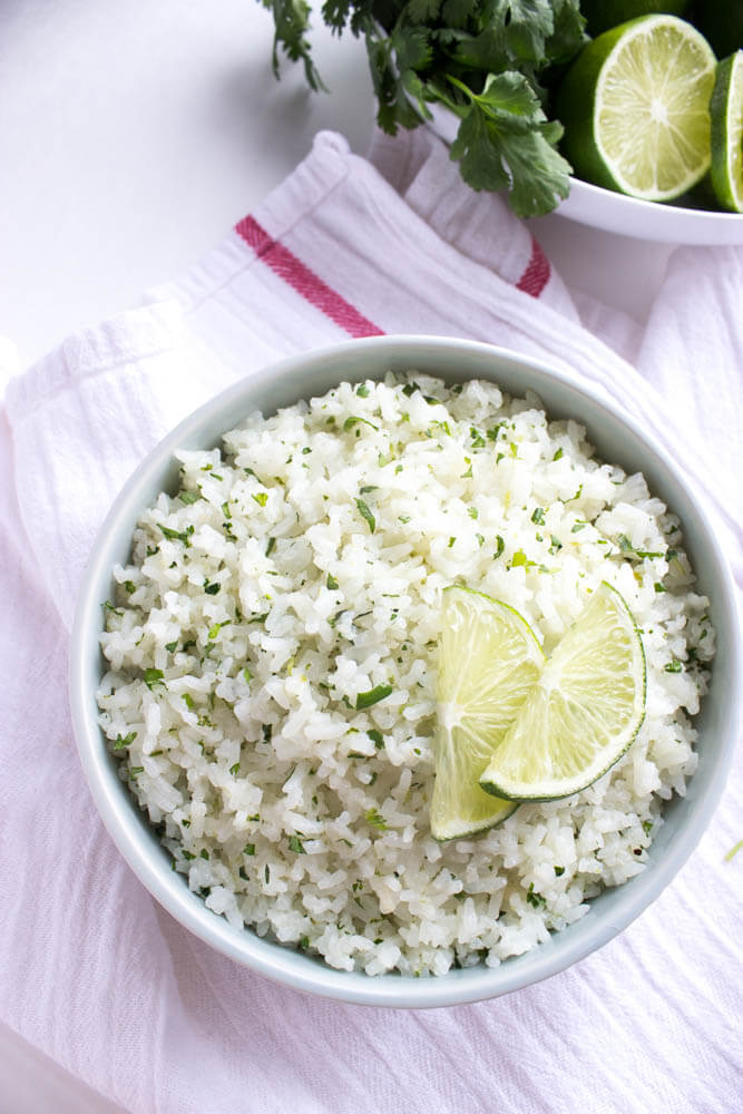The only way to eat rice! Cooked in coconut milk and loaded with fresh cilantro and lime zest! Ultimate side to any meal   littlebroken.com @littlebroken