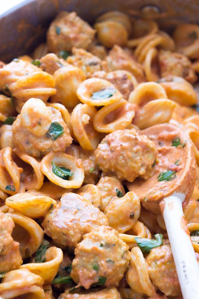Easy skillet pasta dinner with BEST juiciest mini chicken meatballs in a tomato cream sauce   littlebroken.com @littlebroken