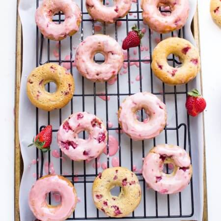 Not your typical baked donuts! Instead these are pillowy soft and airy, packed with sweet juicy strawberries and topped with fresh strawberry glaze | littlebroken.com @littlebroken