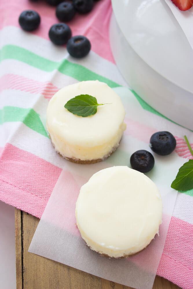Basic cheesecake with graham cracker crust, topped with white chocolate ganache. Super easy, silky, creamy dessert that EVERYONE will love! | littlebroken.com @littlebroken