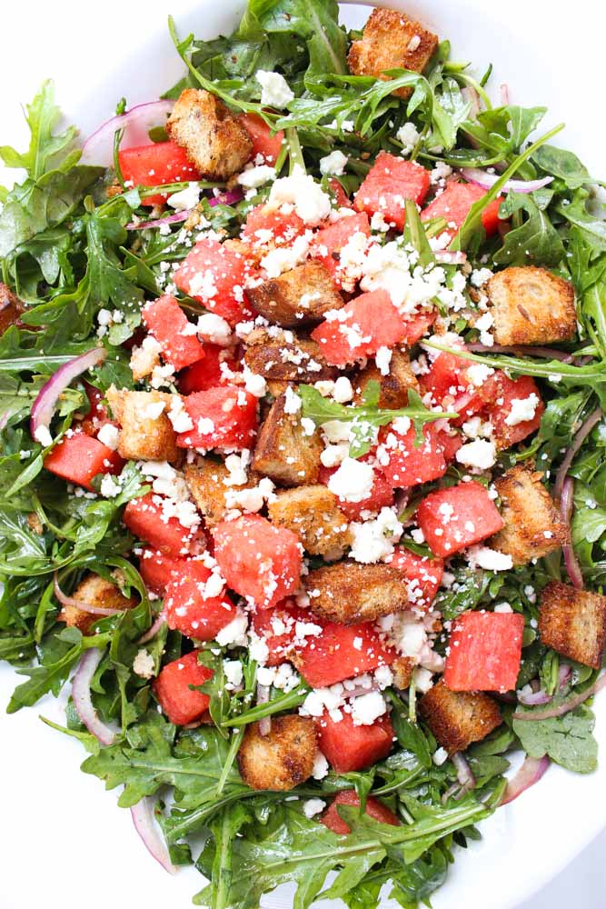 Perfect summer salad of juicy watermelon, crunchy bread, tangy feta on a bed of peppery arugula | littlebroken.com  @littlebroken
