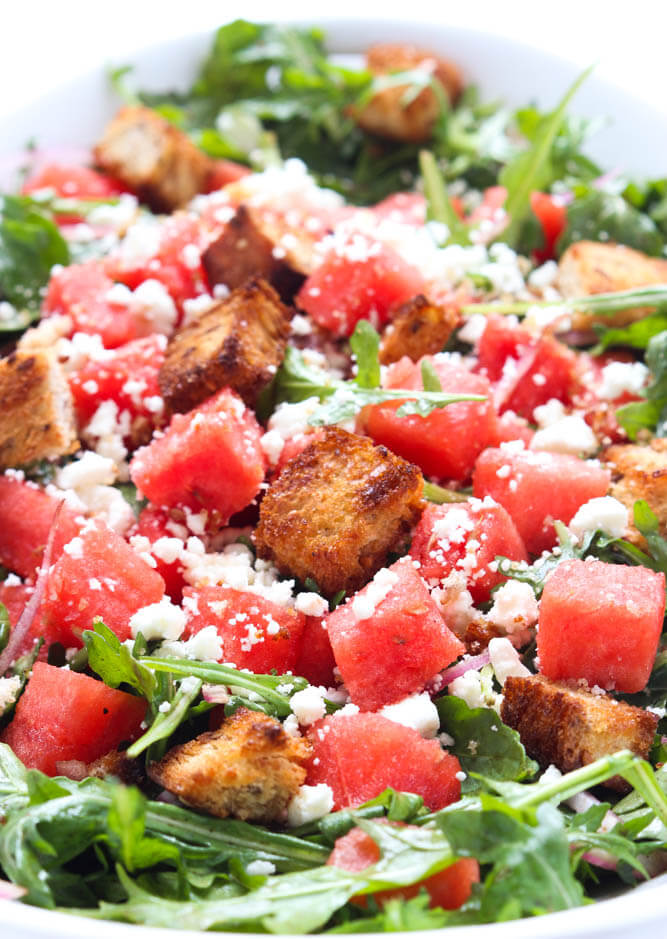 Perfect summer salad of juicy watermelon, crunchy bread, tangy feta on a bed of peppery arugula   littlebroken.com  @littlebroken