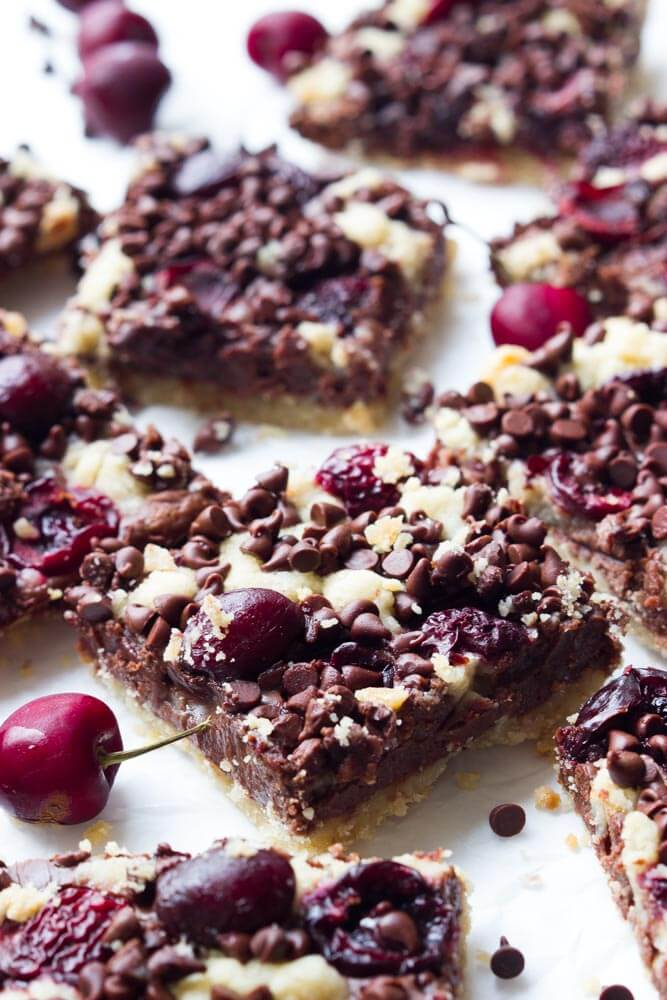 Five layers of absolute bliss - crumb, fudge, cherries, more crumb, and chocolate. All baked in one pan, cut, cooled, and enjoyed with cold glass of milk!  | littlebroken.com @littlebroken