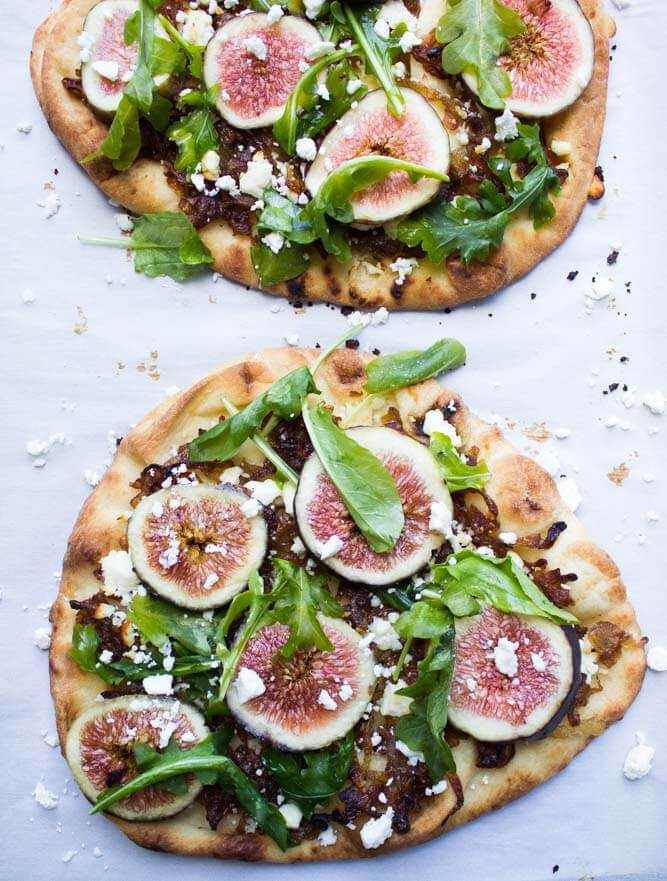 Fresh figs + caramelized onions + arugula + salty feta a top of crisp flatbread. Perfect blend of sweet and savory all in one! | littlebroken.com @littlebroken