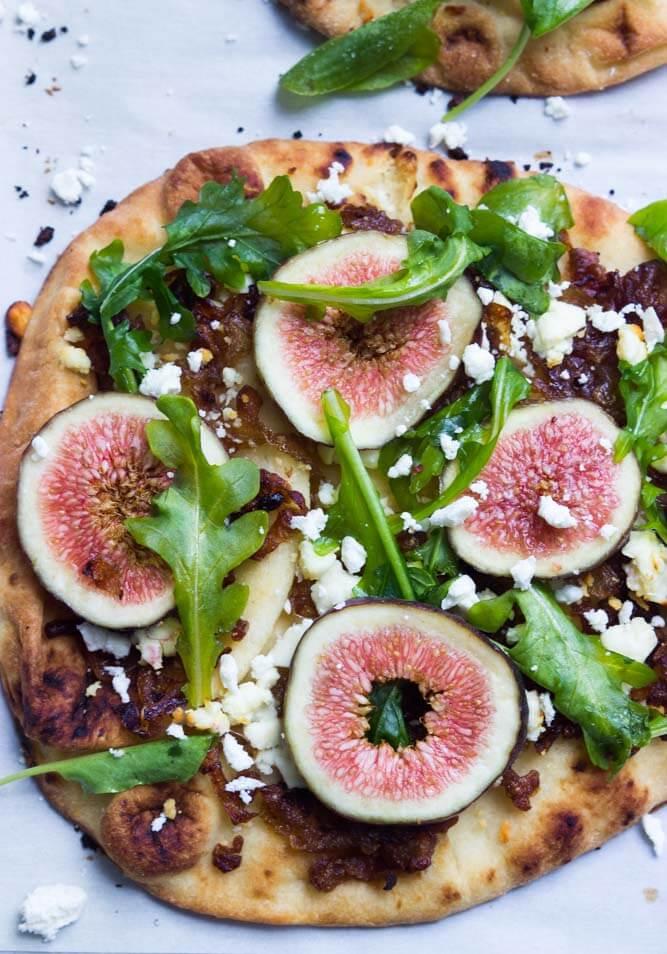 Fresh figs + caramelized onions + arugula + salty feta a top of crisp flatbread. Perfect blend of sweet and savory all in one! | littlebroken.com @littlebroken