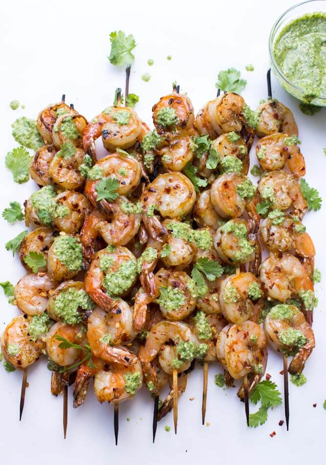 Garlic shrimp skewers made with ton of garlic, red pepper flakes, and paprika. Served with fresh cilantro pesto for a super quick and easy meal   littlebroken.com @littlebroken