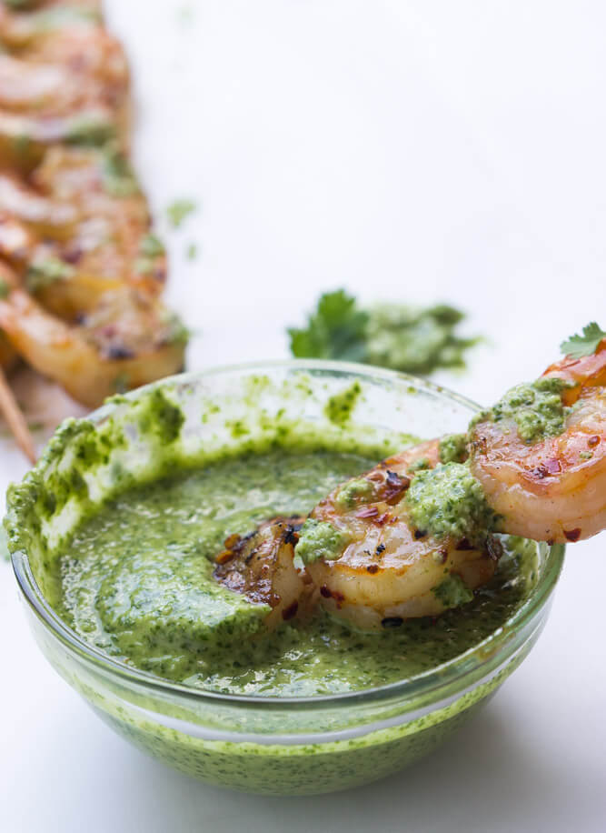 Garlic shrimp skewers made with ton of garlic, red pepper flakes, and paprika. Serve with fresh cilantro pesto. Super quick and easy meal | littlebroken.com @littlebroken