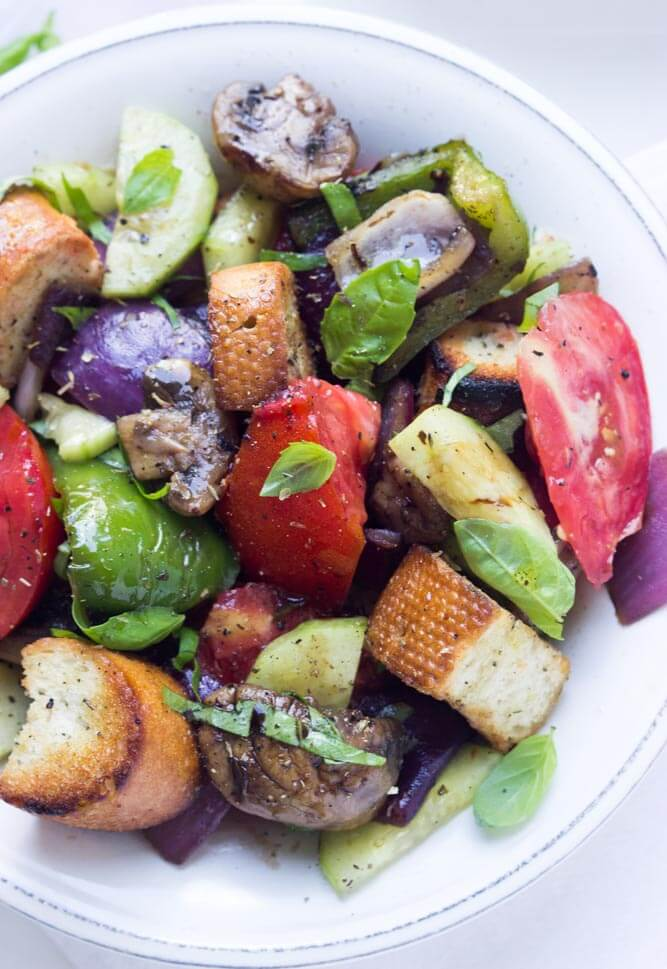 Grilled summer vegetables combined with juicy heirloom tomatoes and grilled croutons. Tossed with fresh basil and balsamic vinegar | littlebroken.com @littlebroken