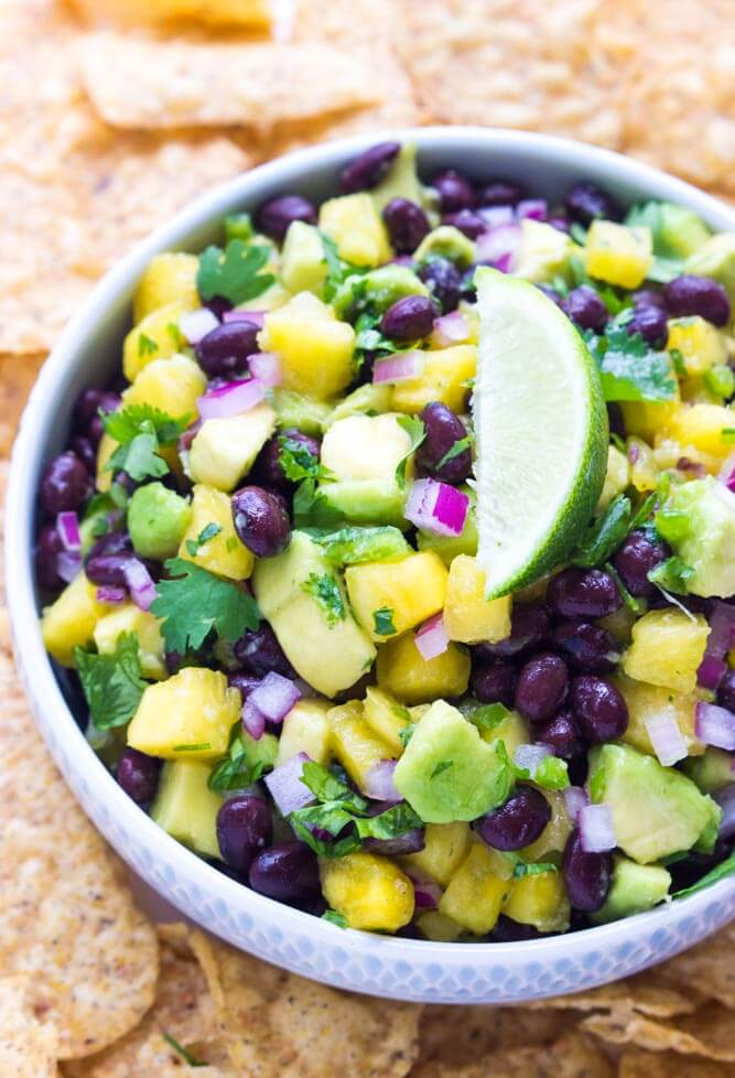 Fresh sweet chunks of pineapple combined with black beans and creamy avocado to make this over the top delicious salsa!   littlebroken.com @littlebroken.com