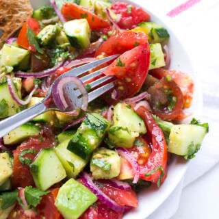 Light and refreshing salad with heirloom tomatoes, avocado, cucumber, cilantro and red onion | littlebroken.com @littlebroken