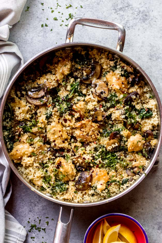 overhead chicken quinoa spinach in saute pan