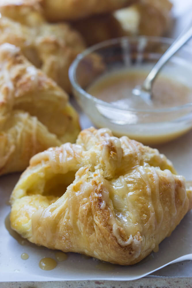 Apple Cheese Danishes with Caramel Glaze - flaky, buttery double cheese danishes with tart apples and simple caramel glaze. With just few simple ingredients you can make these at home! | littlebroken.com @littlebroken