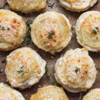 Creamy Potato Stacks with Garlic, Thyme and Parmesan - made in a standard muffin pan, these potato stacks are creamy on the inside and crispy on the outside. Super delicious side for any dinner party! | littlebroken.com @littlebroken