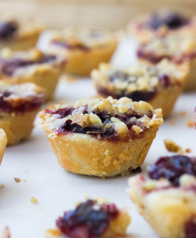 Mini Cherry Pie Bites - flaky buttery crust with cherry filling and walnut streusel. No special techniques required! Make them for Thanksgiving dessert | littlebroken.com @littlebroken