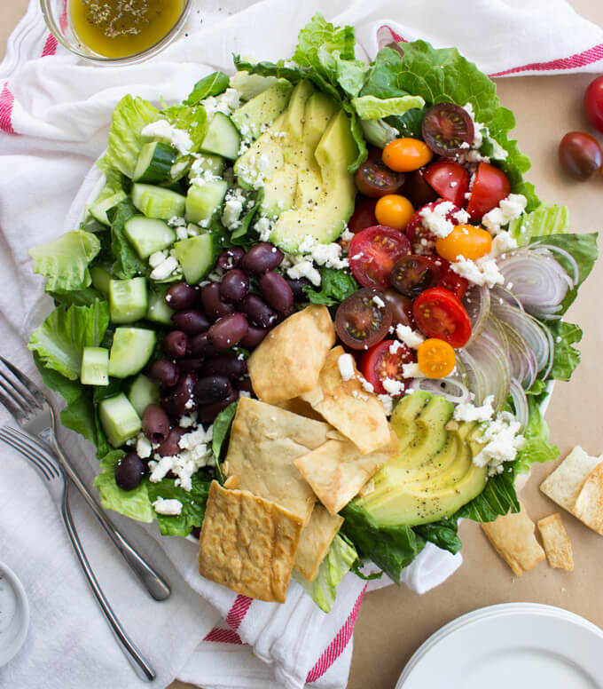Greek Salad with Avocado and Pita Chips - ultimate salad to satisfy every craving! Avocado and pita chip + homemade vinaigrette make this the best salad you'll ever have | littlebroken.com @littlebroken