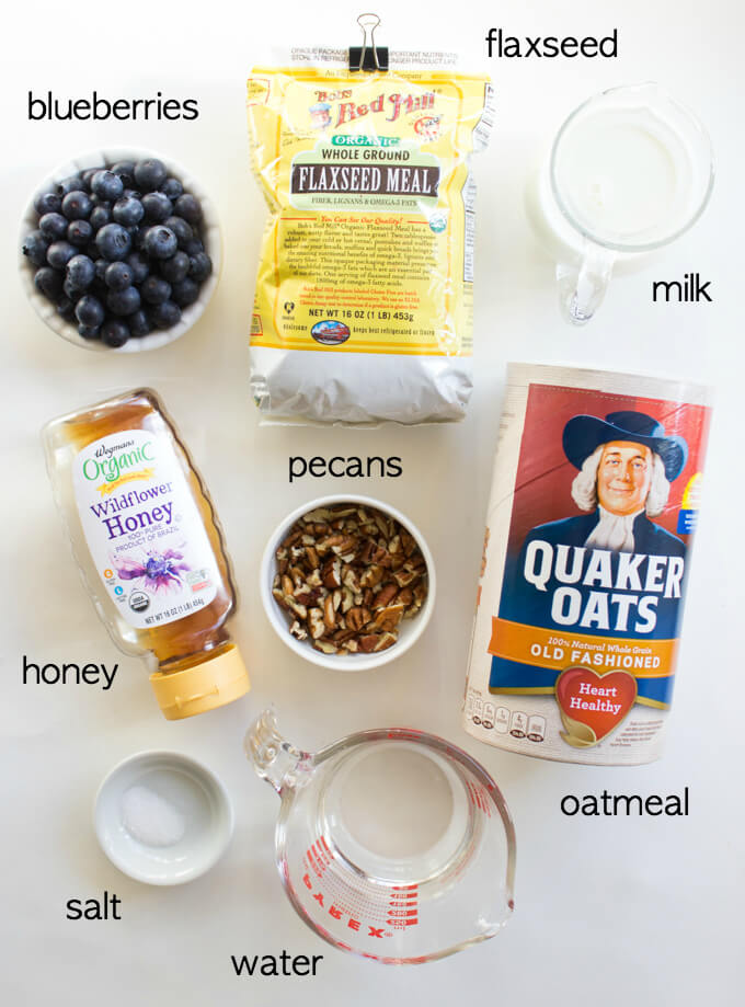 Wholesome Flaxseed and Blueberry Oatmeal - hearty bowl of oatmeal with flax, blueberries, pecans, and drizzle of honey. The best breakfast you'll ever have! | littlebroken.com @littlebroken