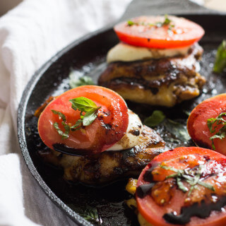 Close up easy caprese chicken in pan.