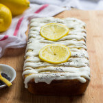 Lemon Poppyseed Cake - super moist lemon cake with poppyseeds, silky layer of cream cheese, and drizzle of luscious lemon cream cheese glaze | littlebroken.com @littlebroken