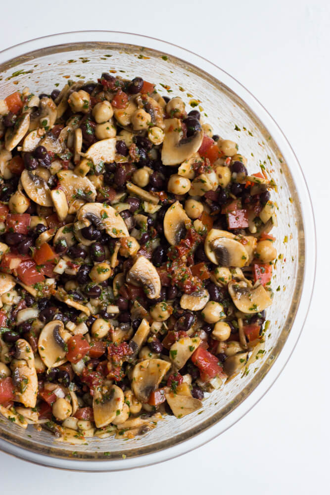 Mediterranean Bean Salad with Mushrooms - this side is a flavor bomb! So easy to make with simple ingredients. Plus it's vegetarian and vegan! | littlebroken.com @littlebroken