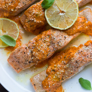 Oven Roasted Salmon with Red Pepper Sauce - flaky salmon with creamy savory-sweet red pepper sauce. Easy and delicious salmon dinner! | littlebroken.com @littlebroken