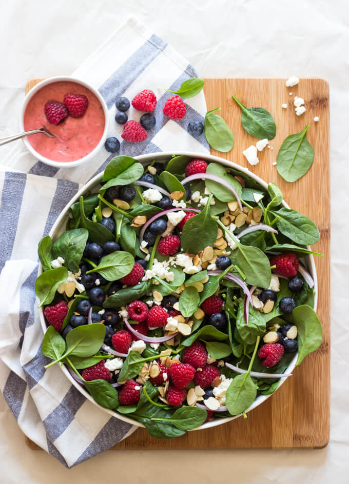 Very Berry Spinach Salad with Raspberry Vinaigrette - beautiful berry spinach salad with feta crumbles and toasted almond slices. Tossed in homemade raspberry vinaigrette. 172 cal | littlebroken.com @littlebroken