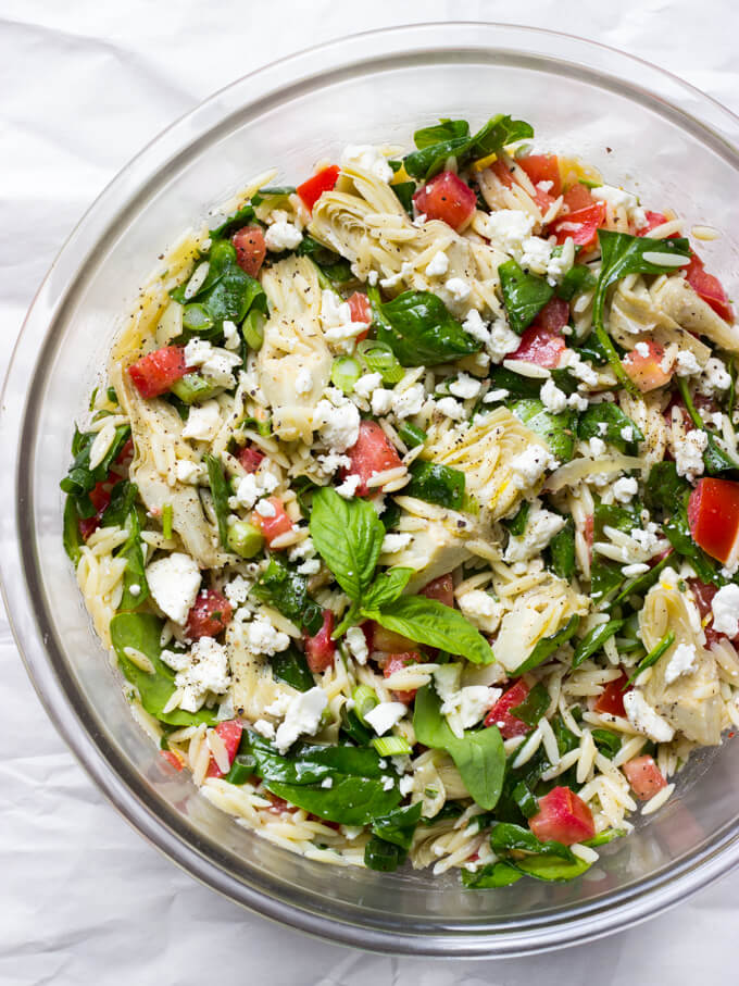 orzo feta spinach salad in glass bowl