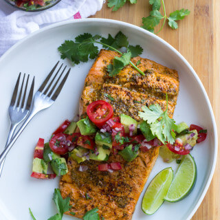Oven Roasted Chili Lime Salmon with Avocado Salsa - chili lime marinated salmon, roasted in the oven, then topped with fresh avocado tomato salsa. Such easy weeknight dinner! | littlebroken.com @littlebroken