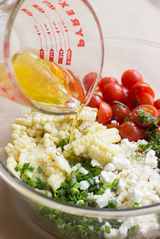 Fresh Sweet Corn Salad with Tomatoes and Feta - the best corn salad to compliment all of your BBQ dishes!   littlebroken.com @littlebroken