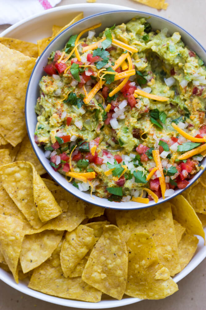 Cheesy Guacamole - traditional guacamole but with cheese! | littlebroken.com @littlebroken