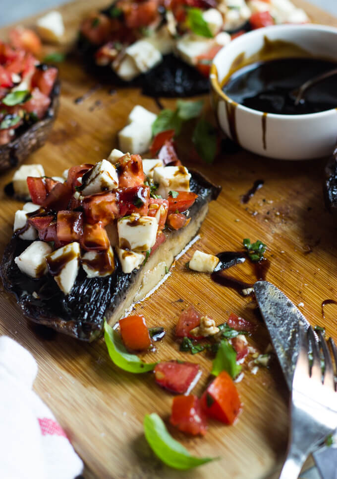 Grilled Portobello Mushrooms with Caprese Salad - juicy, tender, and full of FLAVOR! Not to mention easiest side ever | littlebroken.com @littlebroken