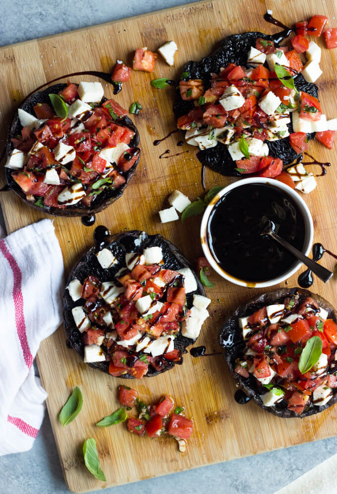 Grilled Portobello Mushrooms with Caprese Salad - juicy, tender, and full of FLAVOR! Not to mention easiest side ever | littlebroken.com @littlebroken