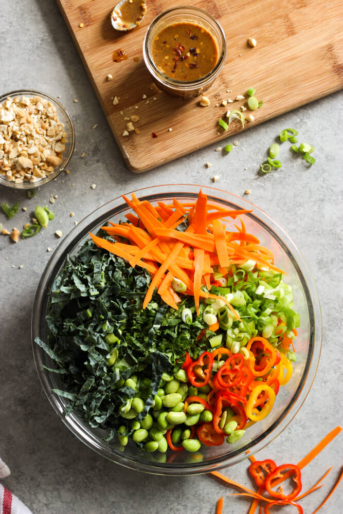 Chopped Kale Salad with Peanut-Chili Vinaigrette - kale, sweet peppers, cilantro, cashews, and edamame tossed in the most flavorful peanut-chili vinaigrette   littlebroken.com @littlebroken
