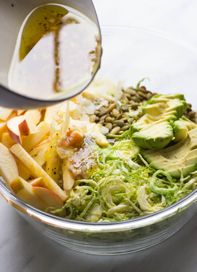 Avocado and Apple Brussels Sprout Salad - thinly shredded sprouts tossed in a savory dressing with avocado, apples, parmesan, and pumpkin seeds | littlebroken.com @littlebroken