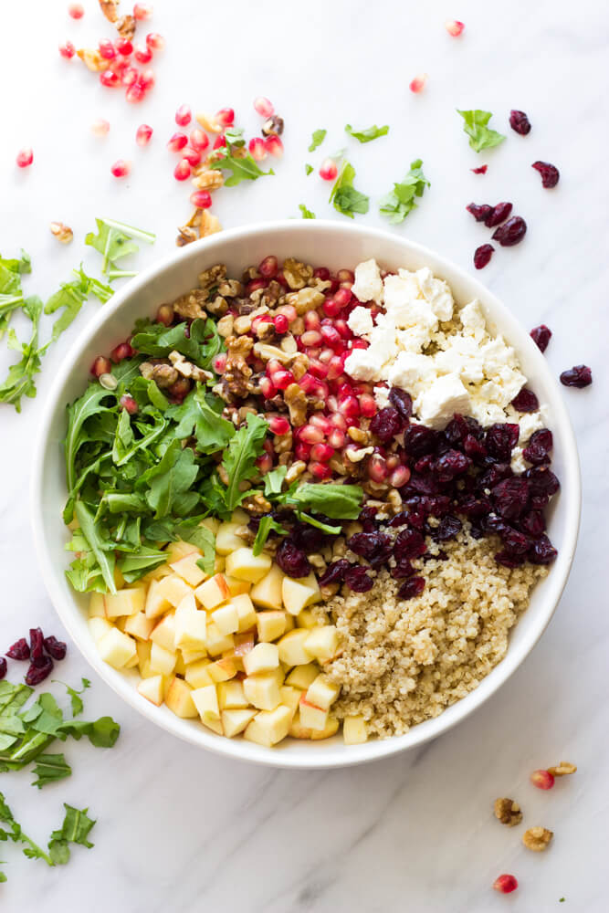 Pomegranate Arugula Quinoa Salad - most festive and delicious salad you will ever make! | littlebroken.com @littlebroken