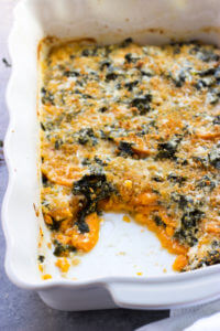 Sweet Potato and Kale Bake - delicious creamy potatoes and leafy kale baked in cheesy sauce. Perfect side for the holidays! | littlebroken.com @littlebroken